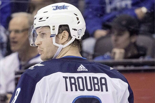 Jacob Trouba was traded to the New York Rangers in exchange for Neal Pionk and a first-round draft pick.