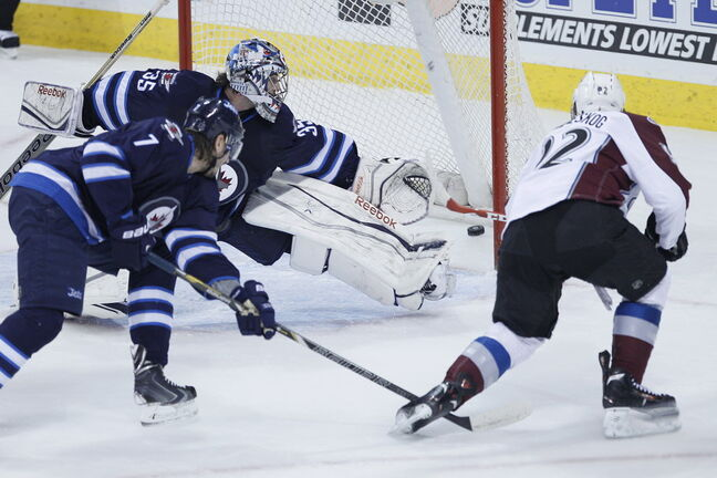 Colorado Avalanche's Gabriel Landeskog (92) rips the puck past Winnipeg Jets' goaltender Al Montoya for their second goal as Jets' Keaton Ellerby looks on during first period NHL action in Winnipeg on Wednesday, March 19, 2014.