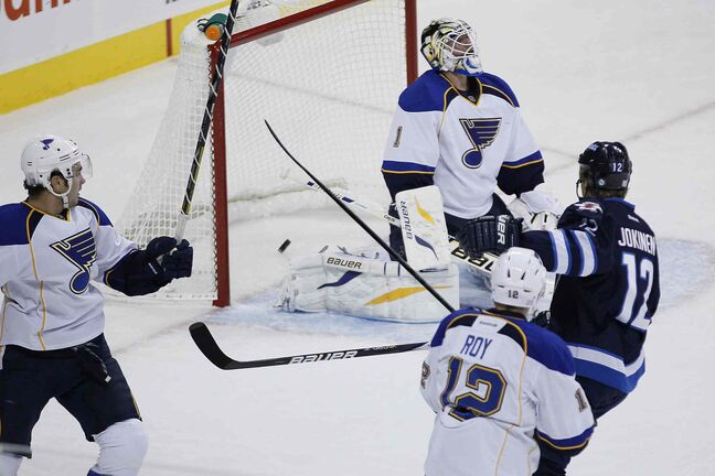 Winnipeg Jets' Olli Jokinen scores on St. Louis Blues goaltender Brian Elliott during the first period.