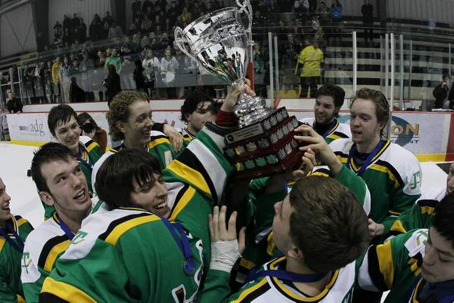 John Taylor Pipers celebrate beating Oak Park Raiders in the Winnipeg High School Hockey League Final at the MTS Iceplex Tuesday February 26, 2013.  