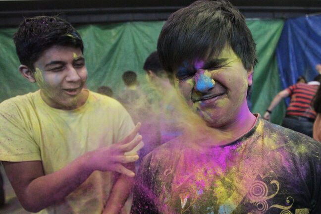 (L-r) Pujan Trivedi, 15, and Dhaval Vora, 14, observe Holi, a religious spring festival celebrated by Hindus as a festival of colours at the Dr. Raj Pandey Hindu Centre Sunday afternoon.