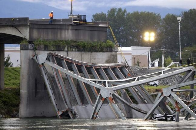 A worker looks at the collapsed portion of the Interstate 5 bridge at the Skagit River on Friday.