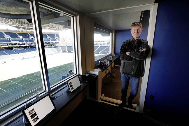 John Graham, President of On Ice Entertainment, in a press box that had to have a wall removed to ensure NFL regulations regarding suite size were met.