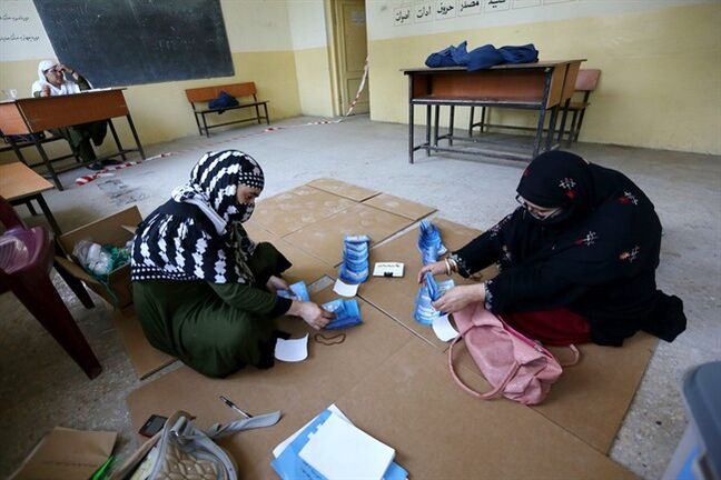 Afghan election workers counts ballots in the presidential runoff at a polling station in Jalalabad, east of Kabul, Afghanistan, Saturday, June 14, 2014. Despite Taliban threats of violence, many Afghans vow to cast ballots in Saturday's presidential runoff vote with hopes that whoever replaces Hamid Karzai will be able to provide security and stability after international forces wind down their combat mission at the end of this year. (AP Photo/Rahmat Gul)