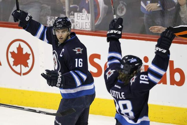 Winnipeg Jets' Bryan Little (left) and Andrew Ladd celebrate Little's goal against the Tampa Bay Lightning during first-period NHL action in Winnipeg on Sunday.