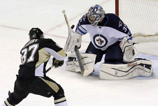 Pittsburgh Penguins captain Sidney Crosby shoots wide on Winnipeg Jets goalie Al Montoya on a first-period penalty shot.
