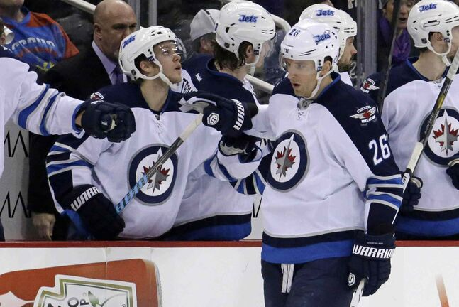 Jets forward Blake Wheeler celebrates with teammates after scoring in the second period.