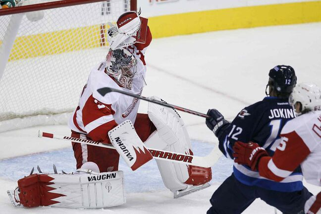 Winnipeg Jets forward Olli Jokinen is robbed by Detroit Red Wings goaltender Jimmy Howard during first-period NHL action.