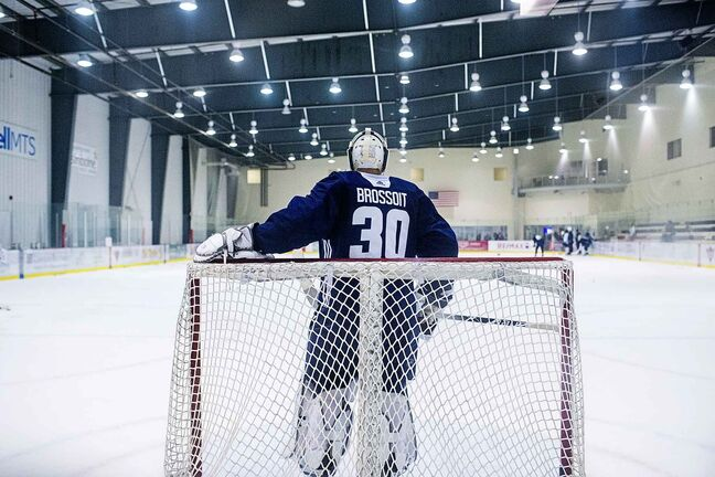 Jets goalie Laurent Brossoit practices at the BellMTS Iceplex.