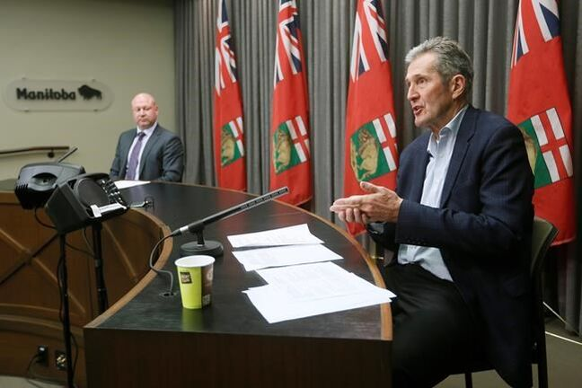 Manitoba Premier Brian Pallister and Dr. Brent Roussin, Manitoba chief public health officer, speak during the province's latest COVID-19 update at the Manitoba legislature in Winnipeg Monday, March 30, 2020. THE CANADIAN PRESS/John Woods