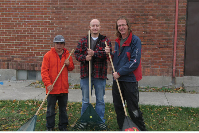 Tung Le (left) and Michael Robert Jackson (centre) are two of SSCOPE Inc.'s many employee members. Marvin Thiessen (right) is SSCOPE's operation supervisor. SSCOPE's workers are ready to help out with all kinds of fall and winter cleanup work.