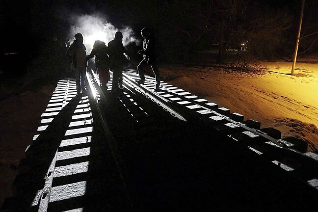 Early Sunday morning, February 26, 2017, eight migrants from Somalia cross into Canada illegally from the United States by walking down this train track into the town of Emerson, Man.