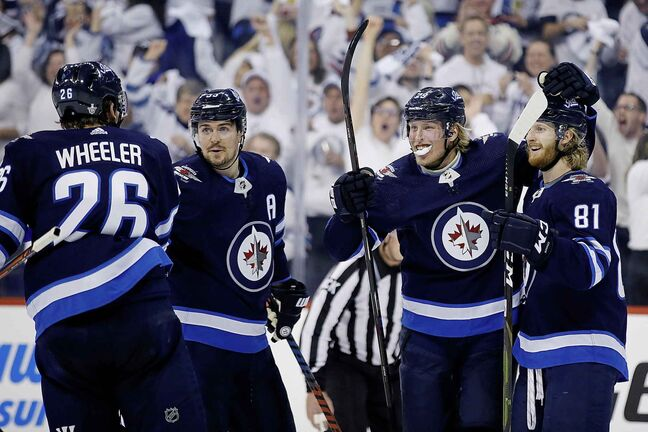 Winnipeg Jets right wing Patrik Laine celebrates his goal.