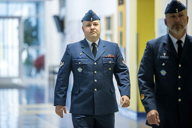 Master Corporal Lewis walks to his court martial at the Canadian Armed Forces base in Winnipeg on Monday.
