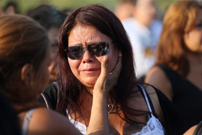 Tina Fontaine attends a vigil in honour of her daughter, Tina Fontaine, and Faron Hall at Alexander Docks in Winnipeg on Tuesday.