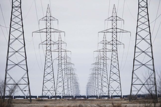A $453-million Manitoba-Minnesota power transmission project has begun ahead of schedule. Manitoba Hydro power lines are photographed just outside Winnipeg, Monday, May 1, 2018. THE CANADIAN PRESS/John Woods