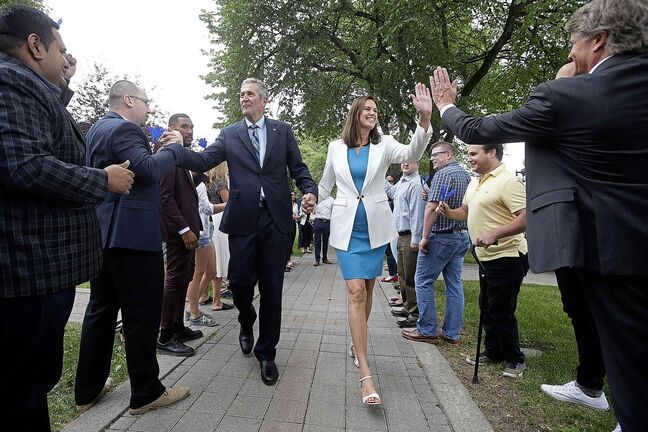 Manitoba Premier Brian Pallister and wife Esther walk through supporters as he heads to announce that the writ has been dropped and he is calling a September election in Winnipeg Monday, August 12, 2019. THE CANADIAN PRESS/John Woods