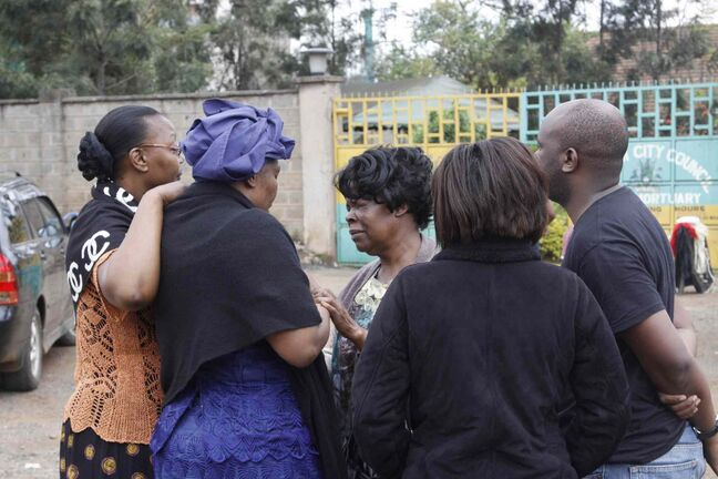 Relatives gather at  the Nairobi City Mortuary Sunday following the mall attack Saturday. Kenyan authorities said Islamic extremist attackers remain inside the upscale Kenyan shopping mall, holding an unknown number of hostages, after killing dozens and injuring 150.