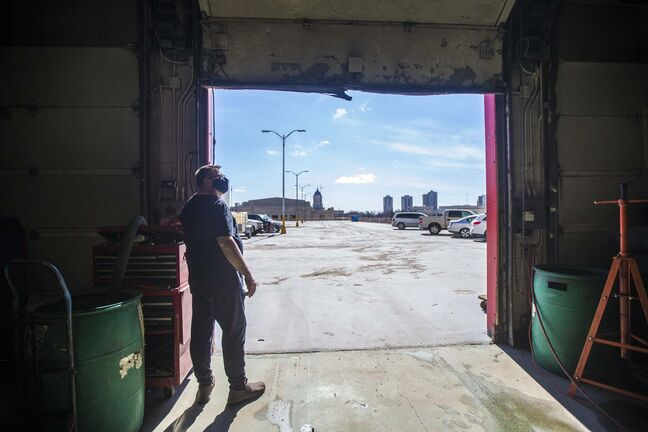 Mike Timlick opens up one of the bay doors to reveal the view.</p>