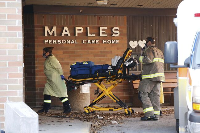 Paramedics arrive at Maples Personal Care Home on Nov. 1. (John Woods / Winnipeg Free Press files)