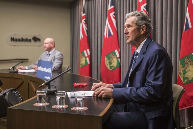 MIKAELA MACKENZIE / WINNIPEG FREE PRESS</p><p>Premier Brian Pallister (right) and chief public health officer Dr. Brent Roussin announce new restrictions at the Manitoba Legislative Building in Winnipeg on Thursday, May 27, 2021. For Larry Kusch story.Winnipeg Free Press 2020.</p>