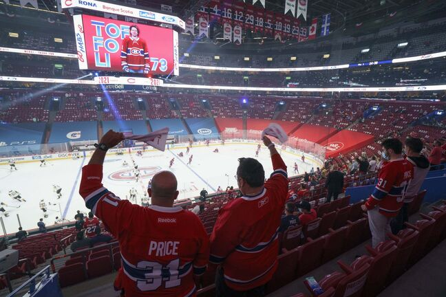 Fans cheer on their team during the pre-game warmup of Game 3 of the NHL Stanley Cup semifinal with the Montreal Canadiens facing the Vegas Golden Knights Friday, June 18, 2021 in Montreal. THE CANADIAN PRESS/Paul Chiasson</p>