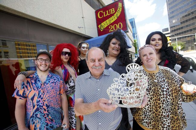 MIKE DEAL / WINNIPEG FREE PRESS</p><p>Miss Club 200 drag queen title holders have launched a fundraising campaign to help one of the city's last remaining LGBTTQ+ bars weather the pandemic. From left: Tom Jansen, co-owner of Not This Fragrance; Lita Takeela; Jessika Venom; Club 200 manager Joel Sarbit with the Miss Club 200 Millennial Crown; Anita Stallion; Courtney Guerin, co-owner of Not This Fragrance; and Cheron Sharelike outside the club at 190 Garry St.</p>
