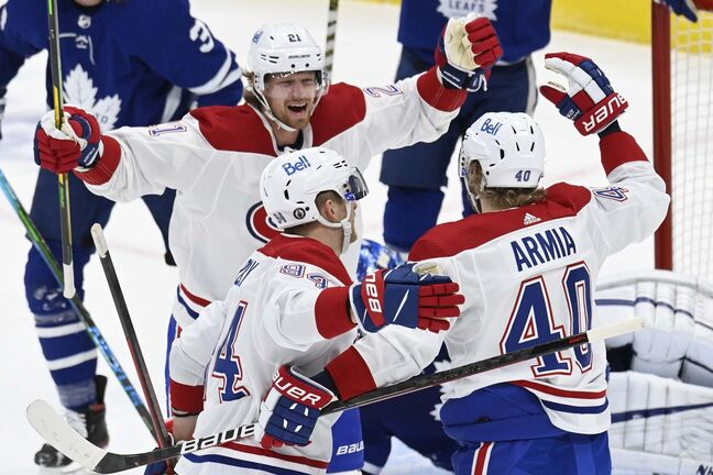 Montreal Canadiens right wing Joel Armia (40) celebrates his goal with teammates Eric Staal (21) and Corey Perry (94) against the Toronto Maple Leafs goaltender Jack Campbell during first period NHL Stanley Cup playoff action in Toronto on Thursday, May 27, 2021. THE CANADIAN PRESS/Frank Gunn</p>