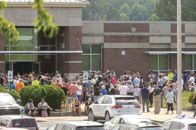 Parents of students from Volunteer High School in Church Hill, Tenn., await news on Aug. 10 after reports of an active shooter, which was eventually declared a hoax and believed to have originated in Manitoba. (Larry N. Souders / The Associated Press files)