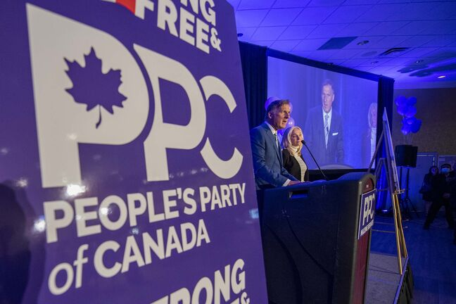 People's Party of Canada Leader Maxime Bernier and wife Catherine Letarte speaks from a podium to supporters during the PPC headquarters election night event in Saskatoon, Sask., Monday, Sept. 20, 2021. THE CANADIAN PRESS/Liam Richards</p>