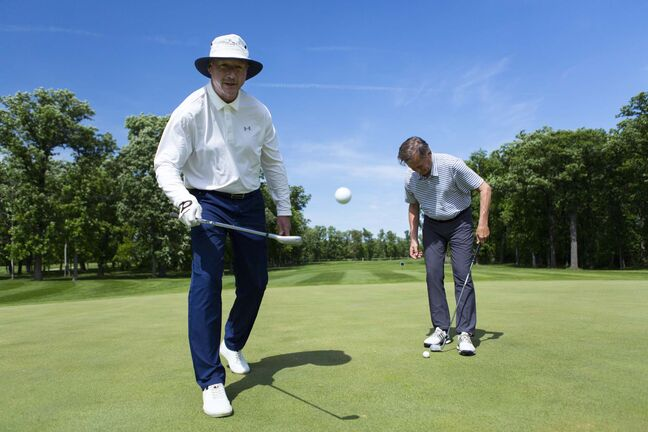 ANDREW RYAN / WINNIPEG FREE PRESS</p><p>Bridges Golf Course Head Pro Larry Robinson (right) and long-time friend Robin Henderson juggle golf balls in friendly competition.</p>