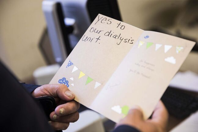 Cross Lake councillor Donnie McKay reads a birthday card sent to the health minister from Cross Lake residents who are yearning for provincial funds to help build a health complex. (MIKAELA MACKENZIE / WINNIPEG FREE PRESS)</p>