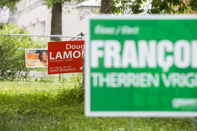 MIKAELA MACKENZIE / WINNIPEG FREE PRESS</p><p>Political signs in St. Boniface before the by-election in Winnipeg on Monday, July 16, 2018. Mikaela MacKenzie / Winnipeg Free Press 2018.</p>