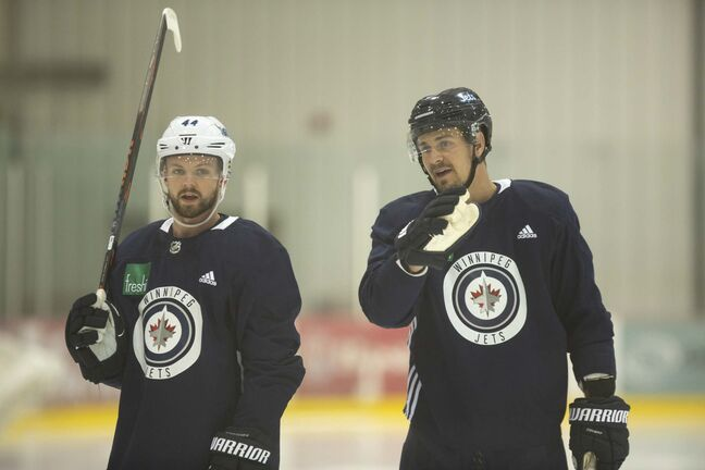 Josh Morrissey (left) and Mark Scheifele skate together Tuesday at the Bell MTS Iceplex. (Andrew Ryan / Winnipeg Free Press)</p>