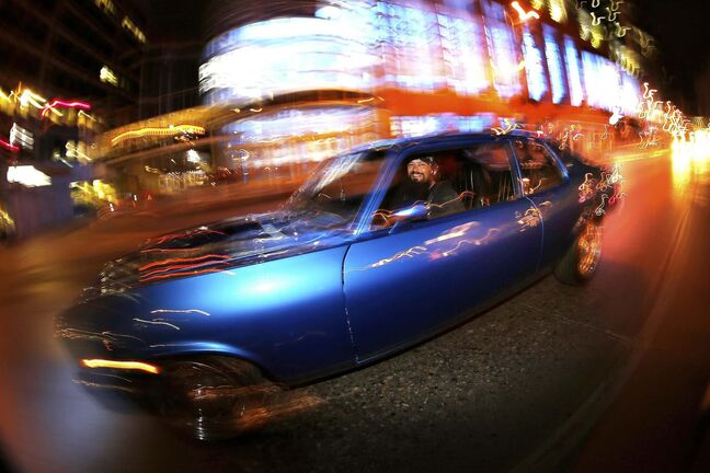 JOHN WOODS / WINNIPEG FREE PRESS</p><p>Mike Teichert cruises down Portage in his 1973 Chevy Nova to the delight of cruise night spectators who revel in the Sunday tradition.</p>
