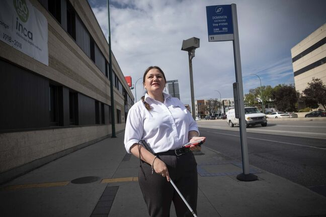 Brianna Fuellbrandt demonstrates the Key2Access app, which allows users to request a pedestrian crossing at traffic lights from their cellphone. Portage Avenue and Dominion Street is one of only two intersections currently set up for users with the app. (Daniel Crump / Winnipeg Free Press)</p>