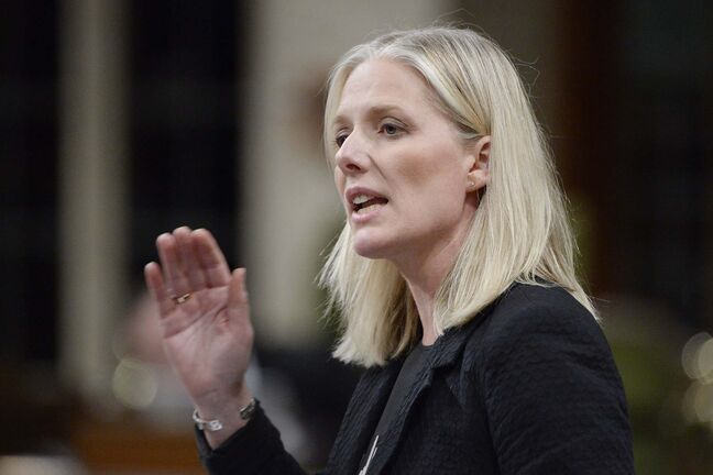 Environment Minister Catherine McKenna said Ottawa is committed to giving Manitoba its share of carbon-tax revenues and the Low Carbon Economy Fund.