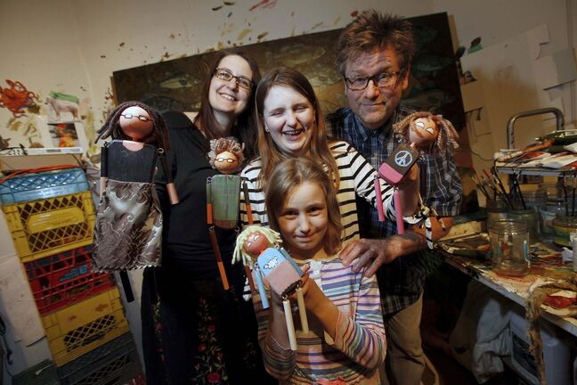 Gord and Megan Wilding with daughters Jasper Lily 12, and Laine 8, and their marionette avatars. The Wilding's toy business, Wooden Squirrel at Work, has fielded orders from as far away as Germany and Japan. (Phil Hossack photos / Winnipeg Free Press)