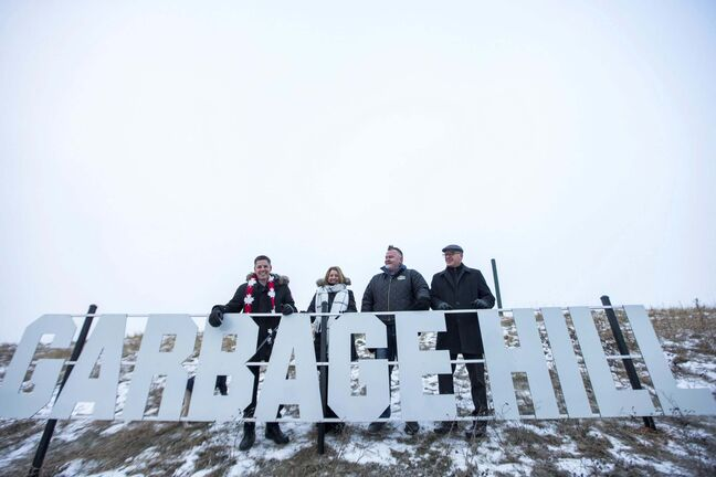 MIKAELA MACKENZIE / WINNIPEG FREE PRESS </p> Mayor Brian Bowman (from left), councillor Cindy Gilroy, President of SRS Signs and Service Inc. Shane Storie, and councillor Scott Gillingham pose with the new Garbage Hill sign.