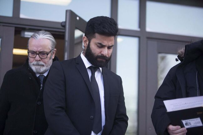 Jaskirat Singh Sidhu leaves provincial court in Melfort, Sask., Tuesday after entering his guilty plea. (Kayle Neis / The Canadian Press)