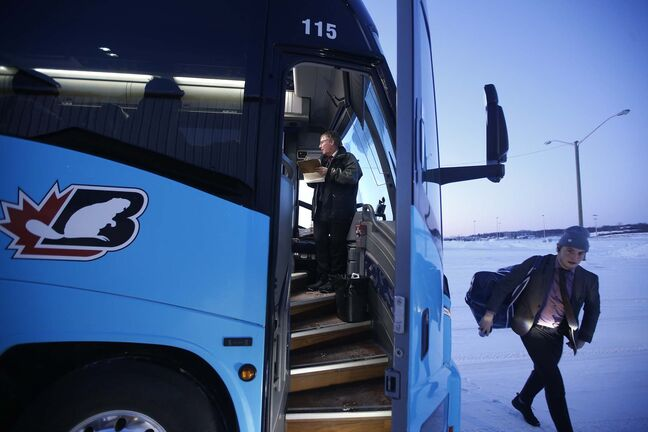 JOHN WOODS / WINNIPEG FREE PRESS</p><p>Roger Hamelin, a bus driver with Beaver Bus Lines, updates his log book on his bus as players head into the arena at Waywayseecappo.</p>