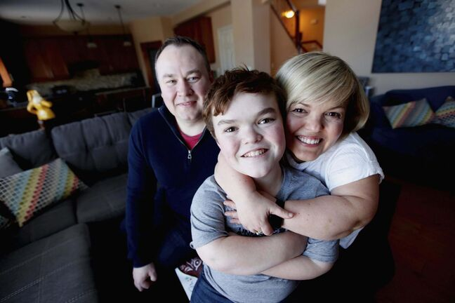 Samantha Rayburn-Trubyk, with her husband Ryan Trubyk and son Yale. (Photos by Phil Hossack / Winnipeg Free Press)