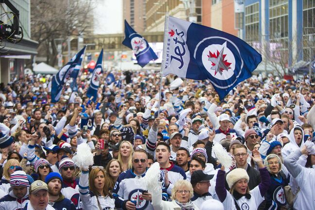 Jets fans flocked by the thousands to whiteout parties outside Bell MTS Place during last season's playoff run. (Mikaela MacKenzie / Winnipeg Free Press files)</p>