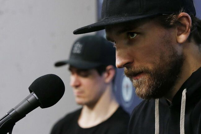 Winnipeg Jets' Mark Scheifele (55), left, and Blake Wheeler (26) listen to media at their closing press conference after losing in the first round of the NHL playoffs in Winnipeg on Monday, April 22, 2019. THE CANADIAN PRESS/John Woods</p>