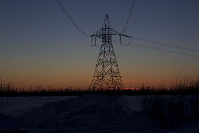 PHIL HOSSACK / WINNIPEG FREE PRESS - Hydro transmission lines lace the sky at Sunset between Gillam and Thompson. Melissa Martin Story. Feb 6, 2019</p>