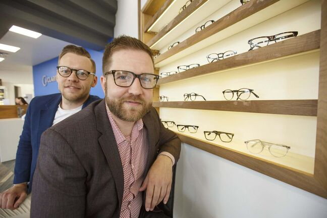 Andrew Aiken (right) and his brother Christopher (left) are making high-end glasses at low price points. (Mike Deal / Winnipeg Free Press)