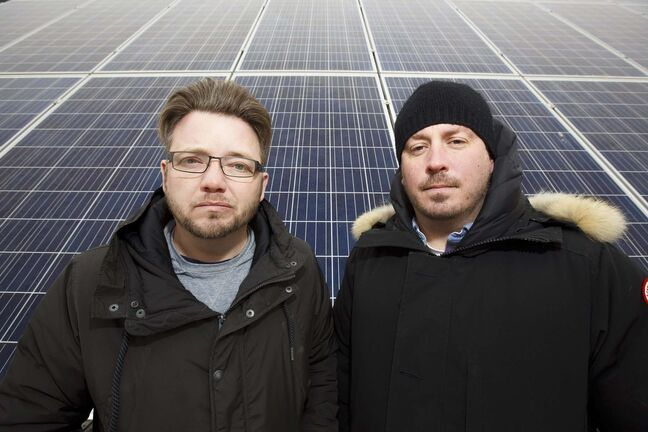 MIKE DEAL / WINNIPEG FREE PRESS(from left) Justin Phillips and Alex Stuart at the solar power array at Fort Whyte Alive. They are partners in the solar installation and design company, Sycamore Energy.191114 - Thursday, November 14, 2019.</p>