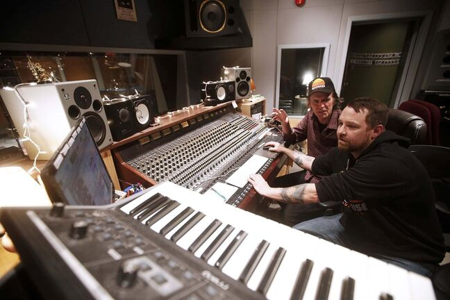 Lloyd Peterson (left) and Rusty Matyas are behind the controls at Moonrise Music Club, a new audio production company. (John Woods / Winnipeg Free Press)