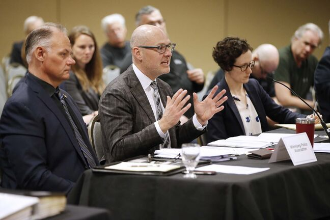 Winnipeg Police Association president Moe Sabourin (left) listens as lawyer Keith LaBossiere tells an arbitrator it is asking for such damages because of the campaign to undermine its pension and union in the eyes of the public. (John Woods / Winnipeg Free Press)