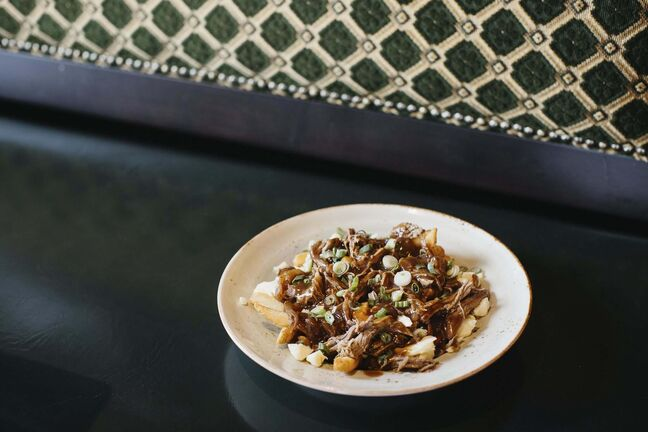 CHARCOAL COLLABORATIVE</p><p>Guinness Tenderloin Poutine, from Fionn MacCool's.</p>